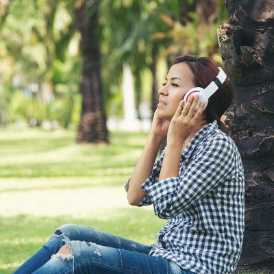 asia-woman-enjoy-listening-music-online-tree-public-park-relax-technology-internet-tings-concept